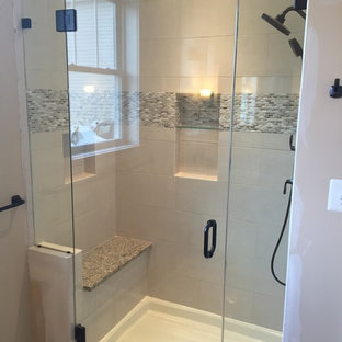 Inspiration for a mid-sized craftsman master white tile and porcelain tile vinyl floor alcove shower remodel in DC Metro with shaker cabinets, medium tone wood cabinets, beige walls, an undermount sink and granite countertops