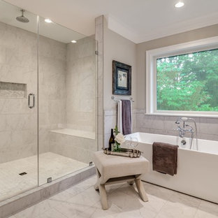 Design ideas for a large arts and crafts master bathroom in DC Metro with flat-panel cabinets, white cabinets, a freestanding tub, an open shower, a one-piece toilet, white tile, porcelain tile, grey walls, porcelain floors, a drop-in sink, marble benchtops, white floor and a hinged shower door.
