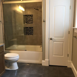 Inspiration for a mid-sized transitional beige tile, gray tile and stone tile slate floor bathroom remodel in DC Metro with flat-panel cabinets, medium tone wood cabinets, a two-piece toilet, gray walls, an undermount sink and granite countertops