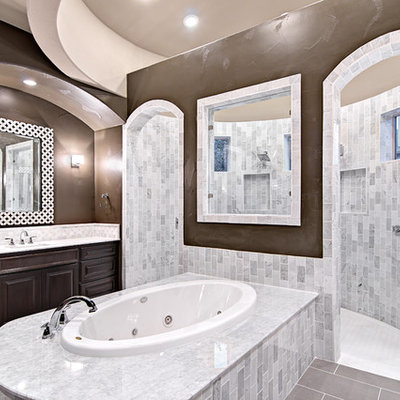 Inspiration for a timeless white tile and stone tile bathroom remodel in Austin