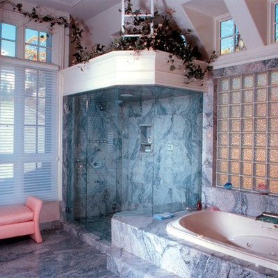 Large cottage chic master marble floor bathroom photo in New York with white walls
