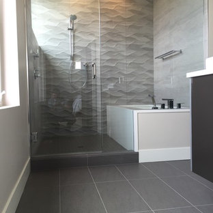 Inspiration for a small contemporary master beige tile and ceramic tile porcelain floor and gray floor alcove shower remodel in Seattle with flat-panel cabinets, dark wood cabinets, an undermount tub, gray walls, a vessel sink, quartzite countertops and a hinged shower door