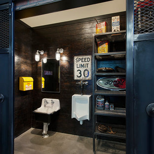 Inspiration for a mid-sized industrial concrete floor bathroom remodel in Calgary with open cabinets, an urinal, brown walls and a pedestal sink