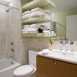 Trendy white tile bathroom photo in Birmingham with an undermount sink, flat-panel cabinets
