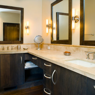 Inspiration for a large contemporary master white tile and stone tile dark wood floor bathroom remodel in Boise with an undermount sink, flat-panel cabinets, dark wood cabinets, solid surface countertops and white walls