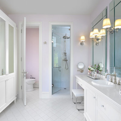 Bathroom - large traditional master white floor bathroom idea in Toronto with white cabinets, pink walls, a drop-in sink, shaker cabinets, a one-piece toilet, quartzite countertops and a hinged shower door