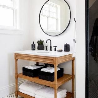 Foto de cuarto de baño tradicional renovado con armarios abiertos, puertas de armario de madera oscura, paredes blancas, suelo de cemento, lavabo bajoencimera, encimera de madera, suelo blanco y encimeras blancas