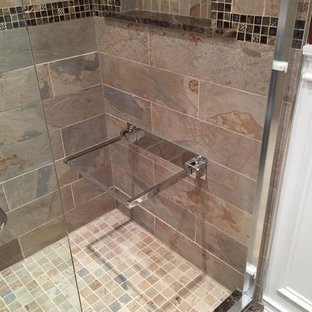 Example of a mid-sized classic master beige tile and porcelain tile porcelain floor and beige floor bathroom design in New York with furniture-like cabinets, gray cabinets, a wall-mount toilet, red walls, an integrated sink and quartzite countertops