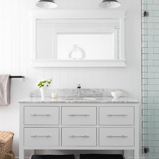 Design ideas for a country bathroom in Brisbane with furniture-like cabinets, white cabinets, a curbless shower, white tile, subway tile, white walls, an undermount sink, multi-coloured floor and white benchtops.