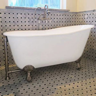 Example of a small ornate master claw-foot bathtub design in Other