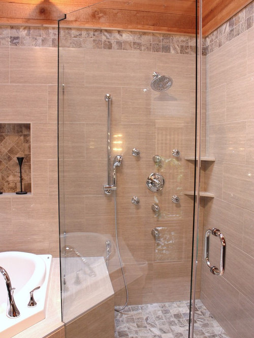 trendy master corner shower photo in other with a dropin tub beige tile