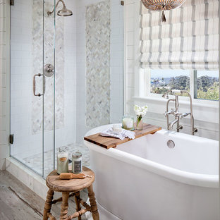 Inspiration for a country master bathroom in San Diego with a freestanding tub, a corner shower, white tile, white walls, painted wood floors and a hinged shower door.