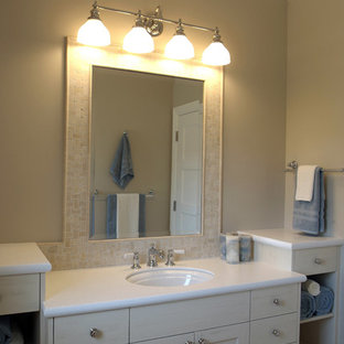 Example of a large classic master marble floor bathroom design in Grand Rapids with recessed-panel cabinets, white cabinets, beige walls, an undermount sink and marble countertops