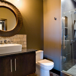 Inspiration for a mid-sized transitional 3/4 beige tile brick floor and multicolored floor alcove shower remodel in Other with flat-panel cabinets, dark wood cabinets, beige walls, a vessel sink, granite countertops, a two-piece toilet and a hinged shower door
