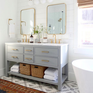 Example of a cottage chic master multicolored floor, double-sink and shiplap wall freestanding bathtub design in Atlanta with gray cabinets, white walls, white countertops and a freestanding vanity