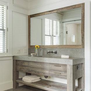 Foto di una grande stanza da bagno padronale chic con ante lisce, ante in legno scuro, vasca sottopiano, piastrelle grigie, piastrelle di cemento, pareti bianche, pavimento in ardesia, lavabo integrato, top in cemento e pavimento grigio