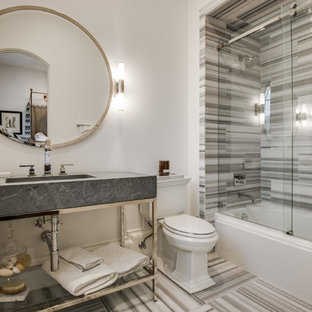 Example of a tuscan bathroom design in Dallas with a two-piece toilet, white walls, open cabinets and gray countertops