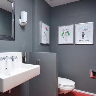 ダラスのコンテンポラリースタイルのおしゃれな浴室 (壁付け型シンク、赤い床) の写真