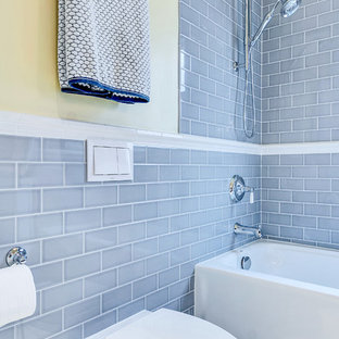 Bathroom - small transitional gray tile and ceramic tile ceramic tile bathroom idea in Dallas with an undermount sink, recessed-panel cabinets, white cabinets, quartz countertops, a wall-mount toilet and white walls