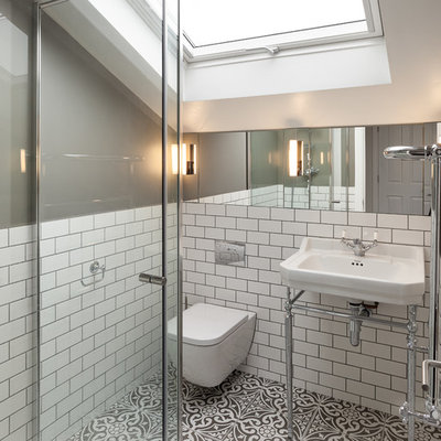 Small ornate master white tile and ceramic tile ceramic tile and multicolored floor corner shower photo in London with glass-front cabinets, a wall-mount toilet, gray walls, a pedestal sink and a hinged shower door