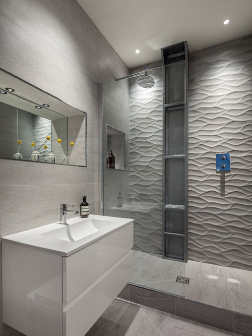 Photo of a medium sized contemporary ensuite bathroom in London with grey  tiles, porcelain tiles