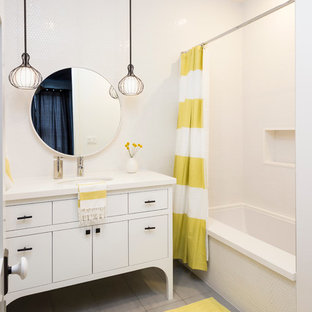 Inspiration for a transitional white tile gray floor alcove bathtub remodel in Los Angeles with an undermount sink, flat-panel cabinets and white cabinets