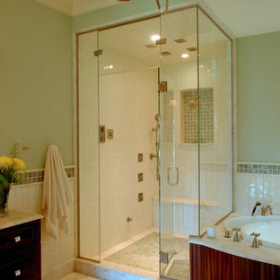 Bathroom - mid-sized beach style master green tile, white tile and ceramic tile marble floor and beige floor bathroom idea in Charleston with recessed-panel cabinets, dark wood cabinets, green walls, an undermount sink, marble countertops and a hinged shower door