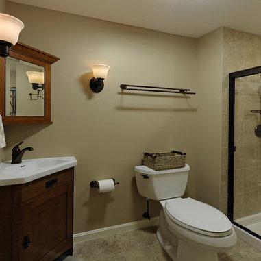 Bathroom with tan tile, light olive walls, slim sink ...