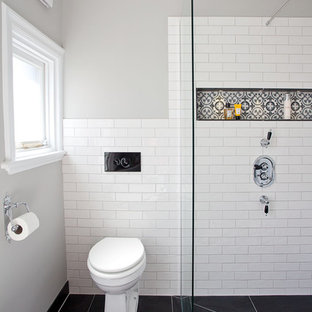 Design ideas for a medium sized contemporary bathroom in Sussex with shaker cabinets, grey cabinets, a freestanding bath, a one-piece toilet, white tiles, metro tiles, grey walls, cement flooring, a built-in sink, marble worktops, multi-coloured floors and an open shower.