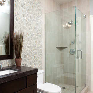 Dark Stained Bathroom Vanity Contrasts with Light Tiles