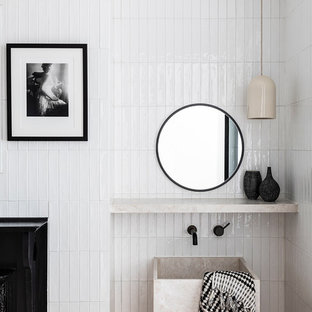 This is an example of a modern bathroom in Sydney with white tile, white walls and a pedestal sink.
