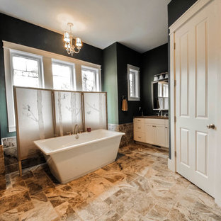 Inspiration for a large transitional master freestanding bathtub remodel in Charleston with shaker cabinets, white cabinets, green walls and an undermount sink
