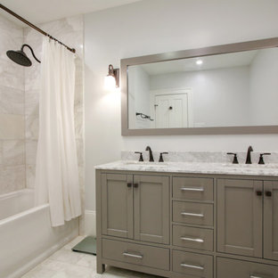 Bathroom - small traditional master white tile and metal tile marble floor and white floor bathroom idea in New Orleans with shaker cabinets, gray cabinets, white walls, an undermount sink, marble countertops and white countertops