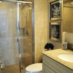 Example of a small beach style 3/4 beige tile and ceramic tile ceramic tile bathroom design in Orlando with raised-panel cabinets, white cabinets, beige walls and granite countertops
