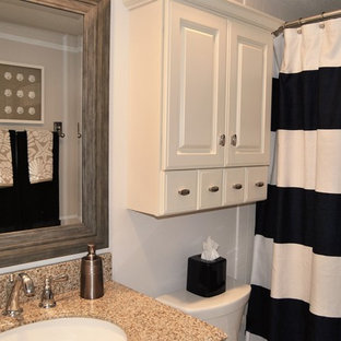 Inspiration for a small coastal beige tile and ceramic tile ceramic tile bathroom remodel in Orlando with raised-panel cabinets, white cabinets, beige walls, an undermount sink and granite countertops