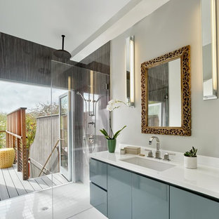 Mid-sized trendy master porcelain floor and white floor bathroom photo in San Francisco with flat-panel cabinets, gray cabinets, gray walls, an undermount sink, quartzite countertops and white countertops