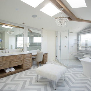 Photo of a beach style master bathroom in Orange County with shaker cabinets, medium wood cabinets, a freestanding tub, a corner shower, multi-coloured tile, white walls, an undermount sink, multi-coloured floor and a hinged shower door.