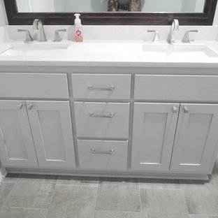 Inspiration for a medium sized classic family bathroom in Other with shaker cabinets, grey cabinets, an alcove bath, a shower/bath combination, a two-piece toilet, white tiles, porcelain tiles, green walls, porcelain flooring, a submerged sink, engineered stone worktops, grey floors, a shower curtain and white worktops.