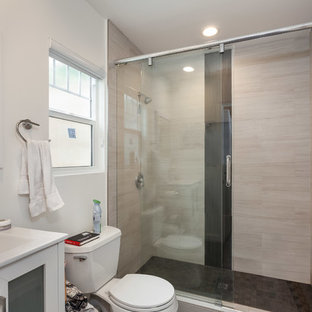 Mid-sized trendy master white tile medium tone wood floor and brown floor bathroom photo in Los Angeles with flat-panel cabinets, white cabinets, white countertops, a two-piece toilet, white walls, a drop-in sink and zinc countertops