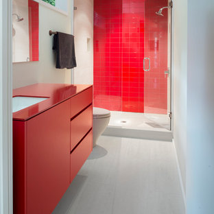 Inspiration for a contemporary 3/4 red tile white floor alcove shower remodel in Atlanta with flat-panel cabinets, red cabinets, white walls, an undermount sink, a hinged shower door and red countertops