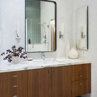 Mid-century modern white tile and mosaic tile gray floor bathroom photo in Boston with flat-panel cabinets, brown cabinets and an undermount sink