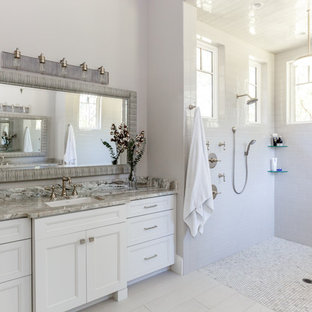 Inspiration for a large transitional master white tile and subway tile porcelain tile and gray floor bathroom remodel in Jacksonville with white cabinets, quartzite countertops, recessed-panel cabinets, gray walls, an undermount sink and gray countertops