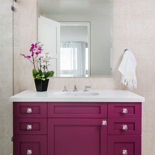 Design ideas for a transitional bathroom in San Diego with shaker cabinets, an alcove shower, beige tile, an undermount sink, beige floor, a sliding shower screen and white benchtops.
