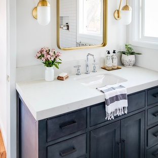 Mid-sized eclectic master porcelain floor and black floor bathroom photo in San Diego with a one-piece toilet, an undermount sink, quartz countertops and white countertops
