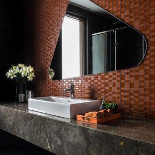 Idées déco pour une salle de bain contemporaine avec un carrelage rouge, une vasque, un sol multicolore, un plan de toilette multicolore et meuble simple vasque.