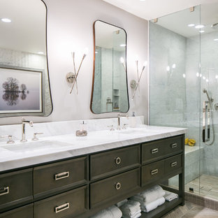 Bathroom - mid-sized transitional master gray tile and marble tile porcelain floor and gray floor bathroom idea in Denver with furniture-like cabinets, brown cabinets, a two-piece toilet, gray walls, an undermount sink, quartzite countertops and a hinged shower door