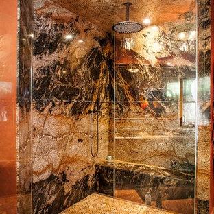 シアトルの大きい地中海スタイルのおしゃれなマスターバスルーム (家具調キャビネット、濃色木目調キャビネット、大型浴槽、コーナー設置型シャワー、オレンジの壁、セラミックタイルの床、ベッセル式洗面器、御影石の洗面台、オレンジの床、開き戸のシャワー、マルチカラーの洗面カウンター) の写真