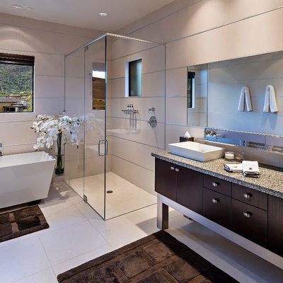 Trendy master bathroom photo in Phoenix with a vessel sink, flat-panel cabinets and dark wood cabinets