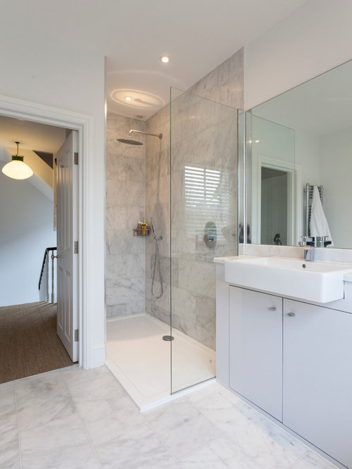 Inspiration For A Contemporary White Tile White Floor Alcove Shower Remodel  In London With Flat
