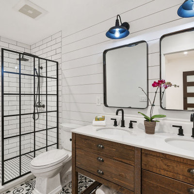 Bathroom - large transitional 3/4 white tile and subway tile double-sink bathroom idea in San Francisco with furniture-like cabinets, medium tone wood cabinets, a two-piece toilet, multicolored walls, an undermount sink, white countertops and a built-in vanity